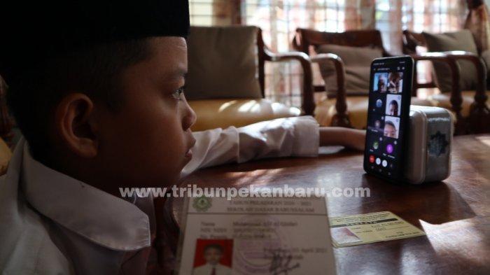 FOTO: Pengumuman Kelulusan Secara Online di Pekanbaru - foto_pengumuman_kelulusan_secara_online_di_pekanbaru_2.jpg