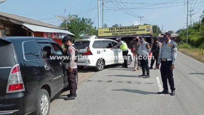 FOTO: Peniadaan Mudik Lebaran 2021, Polda Riau Dirikan 58 Pos Penyekatan - foto_peniadaan_mudik_lebaran_2021_polda_riau_dirikan_58_pos_penyekatan_3.jpg