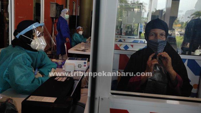 FOTO: Tes Genose C19 di Bandara SSK II Pekanbaru - foto_tes_genose_c19_di_bandara_ssk_ii_pekanbaru_3.jpg