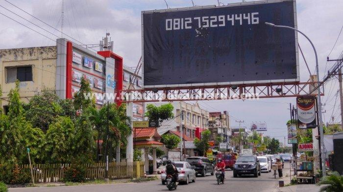 FOTO: Tiang Reklame Ilegal di Pekanbaru Segera Ditertibkan - foto_tiang_reklame_ilegal_di_pekanbaru_segera_ditertibkan_3.jpg