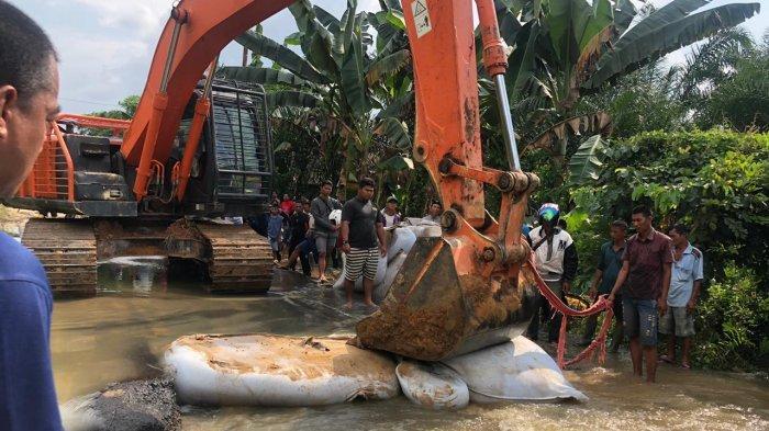 Kadis PUPR Riau Ungkap Apa yang Menyebabkan Jalan Lintas Rengat-Tembilahan Putus Total