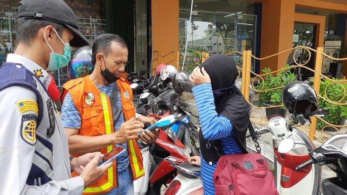 Soal Pembayaran Parkir Tepi Jalan Secara Non Tunai, Juru Parkir di Pekanbaru Mengaku Tahu dari Koran