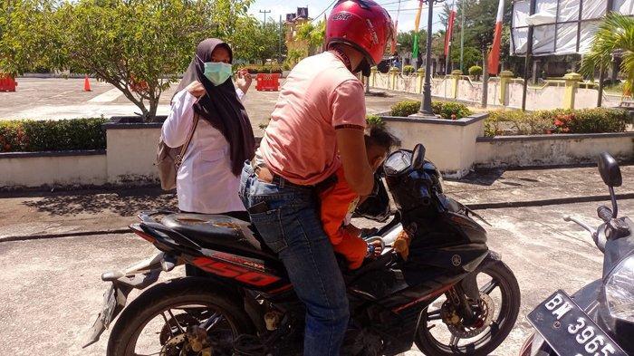Kisah Peserta Seleksi CPNS 2021, Suami Istri Tempuh Perjalanan Antar Pulau Pakai Sepeda Motor
