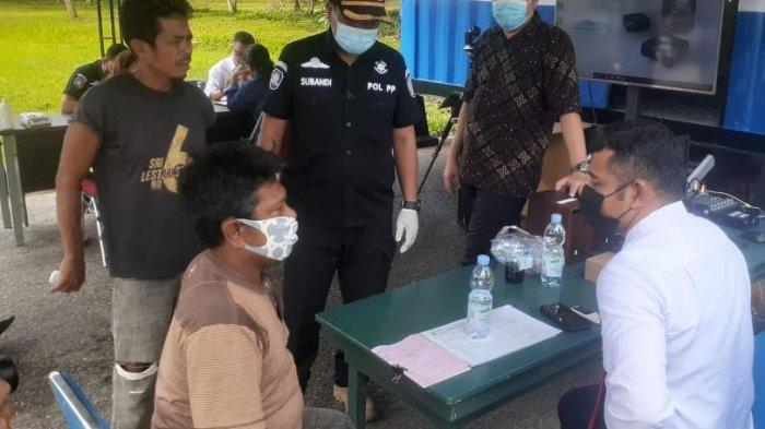 Lupa Pakai Masker, Misnan Kena Denda Satgas Covid Kabupaten Siak