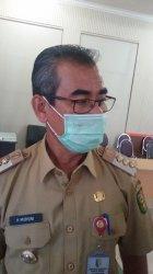 Bupati Kuansing Drs H Mursini / Palti Siahaan