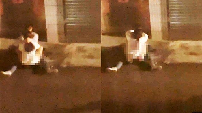 Tak Peduli Ada Orang Lewat, Sepasang Kekasih Asyik Malah Bermesraan di Trotoar, Videonya Viral