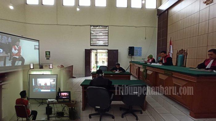 Pengadilan Negeri dan Kejari Pelalawan Gelar Sidang Via Telekonfrence Kasus Karhutla di Riau