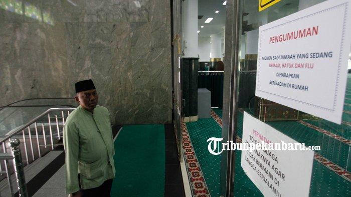FOTO : Mesjid Raya An Nur Pekanbaru Tetap Laksanakan Ibadah Shalat Jumat - pengumuman-di-masjid-an-nur-ibadah-di-rumah-1.jpg