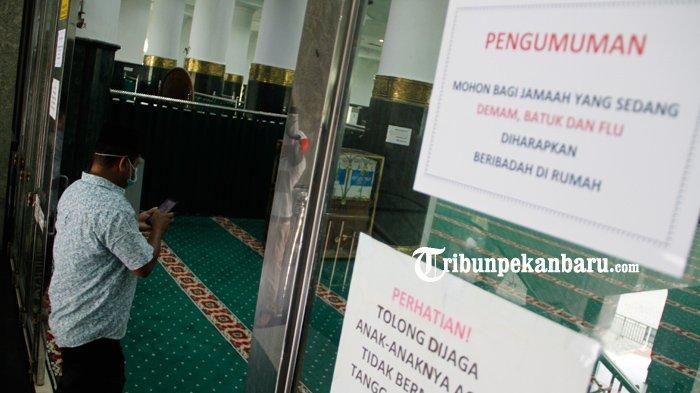 FOTO : Mesjid Raya An Nur Pekanbaru Tetap Laksanakan Ibadah Shalat Jumat - pengumuman-di-masjid-an-nur-ibadah-di-rumah-2.jpg
