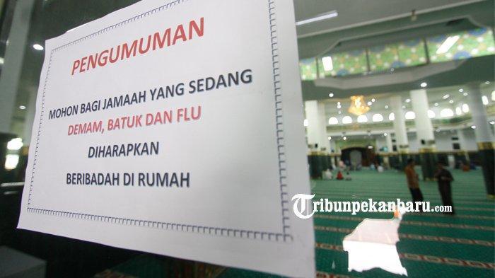 FOTO : Mesjid Raya An Nur Pekanbaru Tetap Laksanakan Ibadah Shalat Jumat - pengumuman-di-masjid-an-nur-ibadah-di-rumah.jpg