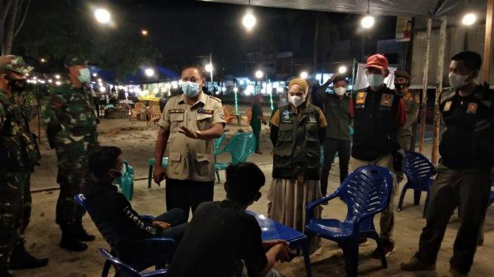 Pengunjung Tempat Kuliner Kena Sasar Saat Tim Yustisi Covid-19 Pelalawan Lakukan Swab di Tempat