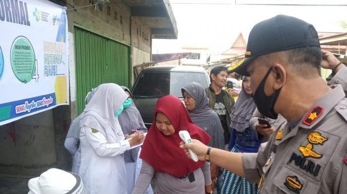 Gelar Rapid Test dan Bagikan Masker Gratis di Pasar, Polsek Tapung Riau Gandeng Puskesmas