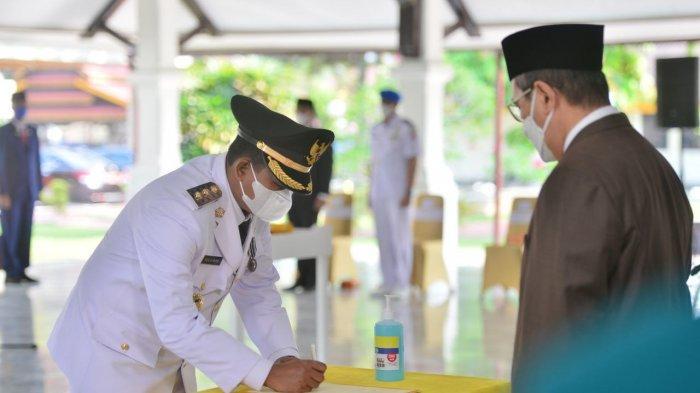 Afrizal Sintong dan H Sulaiman resmi dilantik oleh Gubernur Riau (Gubri) Syamsuar menjadi Bupati dan Wakil Bupati Rokan Hilir (Rohil), Selasa (8/6/2021).