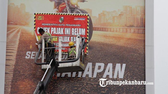 Tunggak Pajak, Langsung Dipasangi Spanduk Peringatan, Ini Penjelasan Bapenda Kota Pekanbaru