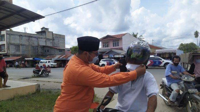 Cegah Penyebaran Covid-19, STIE I Bagikan Masker ke Masyarakat