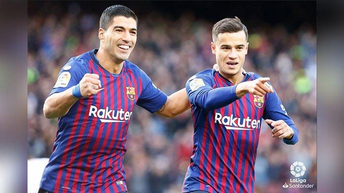 Suarez rayakan gol bersama Coutinho