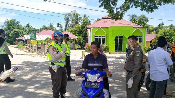 Tujuh Orang Tak Pakai Masker Ditegur Tim Yustisi Kecamatan Sungai Apit, Cegah Penularan Covid-19