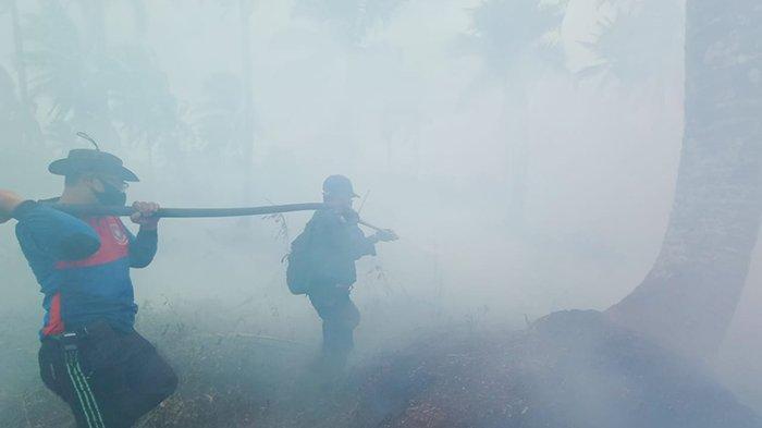 Tim sempat terjebak asap tebal di lokasi Karhutla saat memadamkan api di Kecamatan Kuala Kampar pada Sabtu (13/3/2021) lalu.