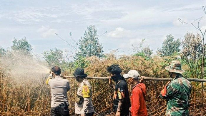Dua Titik Api Terpantau di Desa Pekan Tua Inhil Riau,Tim Gabungan Berjibaku Padamkan Karhutla
