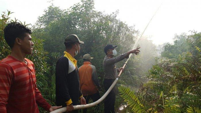 Titik Api di Kuala Kampar Padam Disiram Hujan