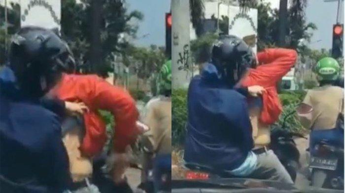 Video Viral, Istri Santai Keroki Suami di Atas Motor Saat Berhenti di Lampu Merah
