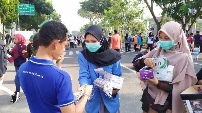 Waspada Covid-19 Suska Volunteer Bagikan Masker Gratis