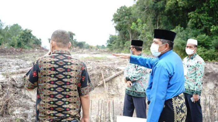 Wujudkan Kota Kembar, Pemkab Siak Buka Jalan Baru di Pinggiran Sungai Siak Belah Mempura