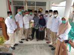 7_anggota_fraksi_gerindra_dprd_pekanbaru_komitmen_maksimal_bantu_masyarakat_sempena_hut_ke-13.jpg