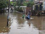 air_sungai_batak_meluap_hingga_ke_jalan_lembah_rayajpg.jpg