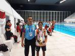 atlet-para-renang-riau-syuci-indriani-kembali-sumbang-medali-asian-para-games-2018_20181011_091859.jpg