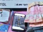 bandar_togel_di_inhu_ditangkap_polisi_saat_berjualan_di_pasar.jpg