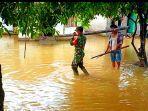 banjir-di-desa-kasang-mungkal-rohul.jpg