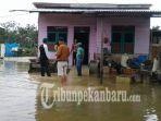 banjir-di-kelurahan-bunut-akhirnya-surut2_20181014_151438.jpg