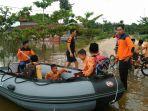 banjir-di-pelalawan-lagi-rendam-sekolah_20170309_114402.jpg