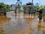 banjir-jalan-cengkeh.jpg