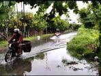 banjir_di_jalan_putri_tujuh_panam_pekanbaru.jpg