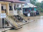 banjir_di_pelalawan_air_surut_akses_jalan_desa_lubuk_kembang_bunga_sudah_bisa_dilewati_kendaraan.jpg