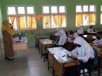 belajar_tatap_muka_di_sekolah_pekanbaru_tambah_jadi_4_jam_peserta_didik_ini_senang.jpg
