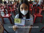 foto-anak-anak_ikut_vaksinasi_massal_covid-19_di_pekanbaru_3.jpg