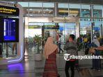 foto_akibat_kabut_penerbangan_di_ssk_ii_pekanbaru_sempat_terganggu_3.jpg