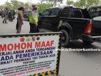 foto_aparat_gabungan_kembali_gelar_razia_masker_di_kecamatan_tampan_pekanbaru_2.jpg