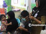 foto_kabut_asap_masih_melanda_pekanbaru_pasien_ispa_di_puskesmas_meningkat_2.jpg