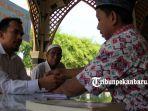foto_membayar_zakat_fitrah_di_masjid_ar_rahman_pekanbaru_2.jpg