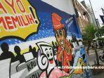 foto_mural_sosialisasi_pemilu_2019_di_pekanbaru_1.jpg