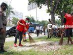 foto_pelanggar_protokol_kesehatan_di_pekanbaru_pilih_kerja_sosial_3jpg.jpg
