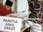 foto_pembayaran_zakat_fitrah_di_pekanbaru_2.jpg