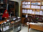 foto_penjualan_baju_seragam_sekolah_di_pekanbaru_mulai_meningkat_3.jpg