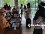 foto_peserta_skb_cpns_di_pekanbaru_gunakan_masker_dan_face_shield_2.jpg