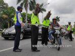 foto_puluhan_orang_terjaring_razia_masker_di_depan_purna_mtq_pekanbaru_3.jpg