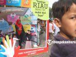 foto_puncak_peringatan_hari_tbc_se_dunia_di_pekanbaru_5.jpg